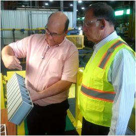 Mike McDonald, Inside Sales Manager at Taber Extrusions explains pieces manufactured by Taber to Senator John Boozman.