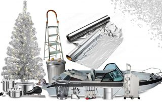 Aluminum Christmas tree surrounded by aluminum items such as a boat, cookware, ladder, aluminum foil