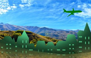 Beautiful country side with grassy mountain vistas and artistically-styled green cityscape & airplane