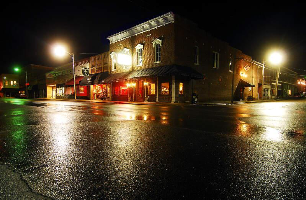 Late night street corner in downtown Russellville, Arkansas after a fresh rainfall.