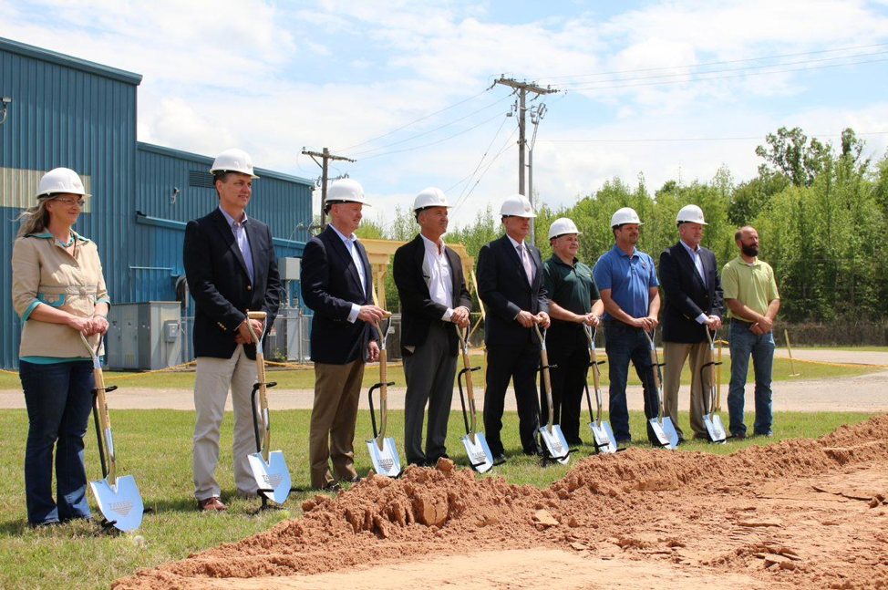 Arkansas Local and state leaders pose with groundbreaking shovels alongside Taber executives and employees at a sunny April 2019 afternoon ceremony.