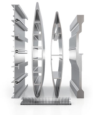 Four, large cross-sectional profiles of aluminum parts with different patterns, shapes, and widths, and underneath an aluminum tablet with micro-aluminum profiles.