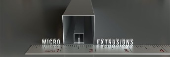 ": The word ""microextrusions"" reflects on a metal ruler up to the 4-inch mark, with 3 sizes of square hollow-shaped miniature extrusions lined up against the 1-2-inch marks."