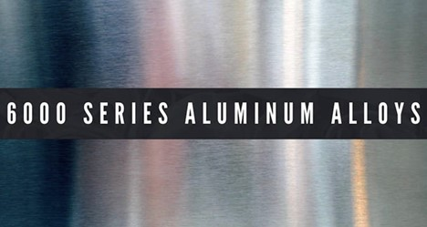 """An artistly presented sheet of aluminum with a vague reflection of red and blue shapes behind a charcoal colored rectangle across the center of the picture with the words: """"6000 SERIES ALUMINUM ALLOYS."""""""