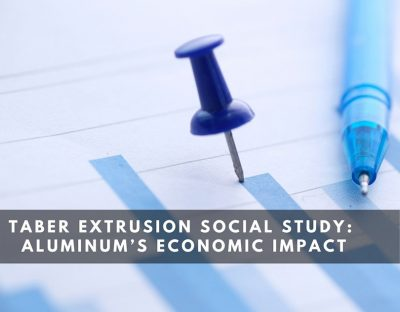 """A photograph of a piece of paper, a dark blue pushpin is affixed at the top of a bar graph alongside a blue pen below which are the words """"Taber Extrusion Social Study: Aluminum's Economic Impact."""""""