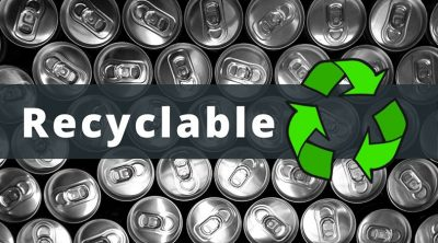 """An image of the tops of a bunch of shiny, unopened aluminum cans beneath a gray banner with the word """"Recyclable"""" and a graphic of the green recycling symbol next to it."""