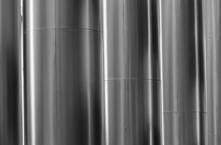 A picture of a shiny grey wall of aluminum sheets.